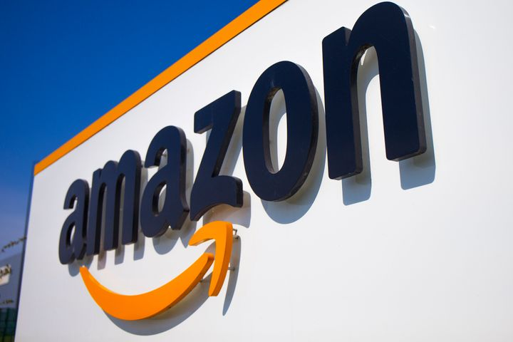 In this Thursday, April 16, 2020 file photo, a logo at the entrance of Amazon, in Douai, northern France. (AP Photo/Michel Sp