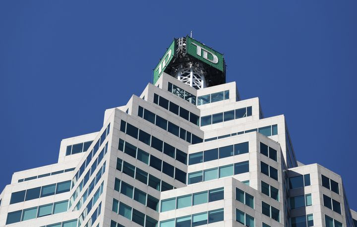 The TD bank logo is seen on top of the Toronto Dominion Canada Trust Tower in Toronto, March 16, 2017. TD Bank says it won't finance oil and gas-related activities in the Arctic.
