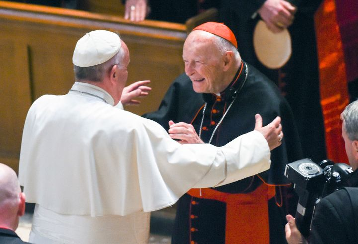 In this Sept. 23, 2015 file photo, Pope Francis reaches out to hug Cardinal Archbishop emeritus Theodore McCarrick after the