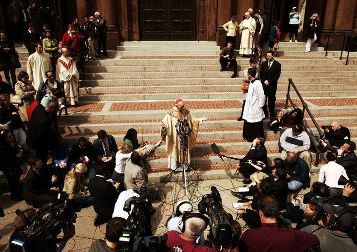 In this photo from April 1, 2005, then-Cardinal Theodore McCarrick answers questions from the media following an afternoon ma