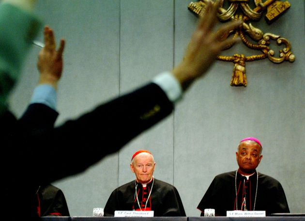 In this photo from April 24, 2002, then-Cardinal Theodore McCarrick answers questions from journalists...