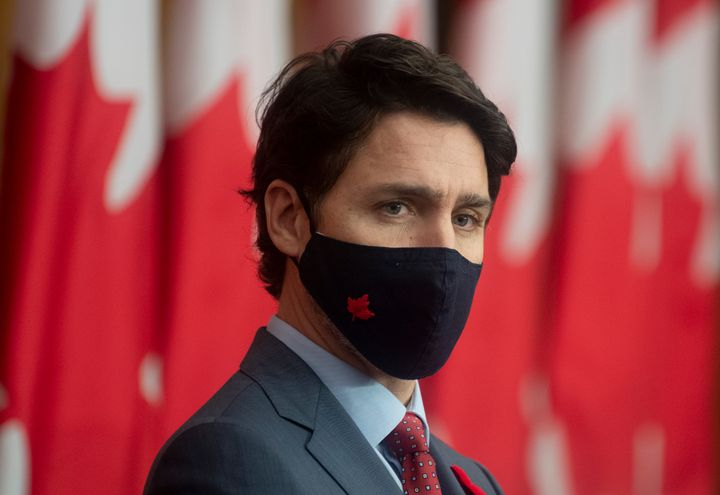 Prime Minister Justin Trudeau listens during a news conference in Ottawa on Nov. 10, 2020.