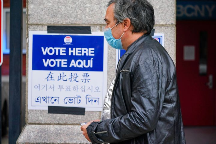 A sign in multiple languages at an early voting site in New York City on Oct. 24, 2020. AAPI advocates say providing resource