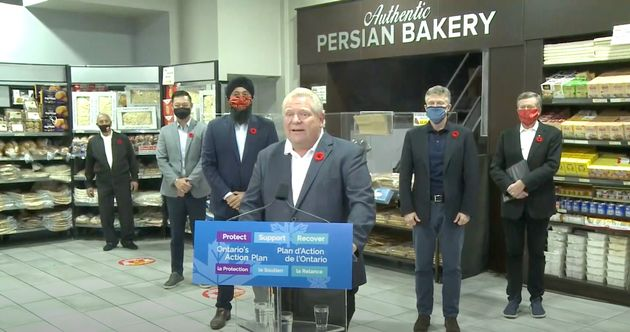 Ontario Premier Doug Ford takes questions from reporters at a North York, Ont. bakery