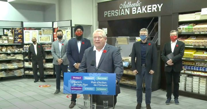 Ontario Premier Doug Ford takes questions from reporters at a North York, Ont. bakery Tuesday.