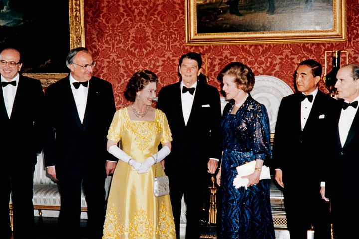 Queen Elizabeth II and Margaret Thatcher along with French President François Mitterrand, Japanese Prime Minister Yasuhiro Nakasone, U.S. President Ronald Reagan, Chancelor Helmut Kohl of West Germany and Italian Prime Minister Bettino Craxi at Buckingham Palace on Sept. 6, 1984.