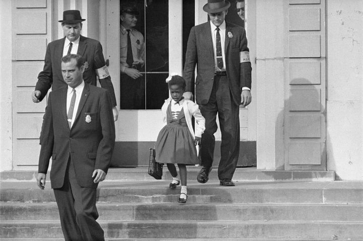 U.S. Deputy Marshals escort 6-year-old Ruby Bridges from William Frantz Elementary School in New Orleans, in this November 19