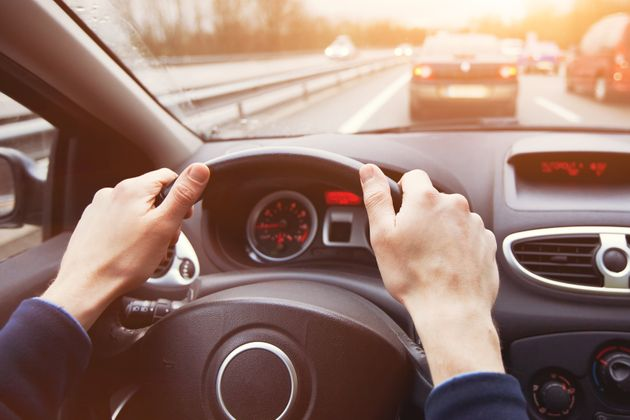 traffic jam, driving car on highway, close up of hands on steering wheel in sunny