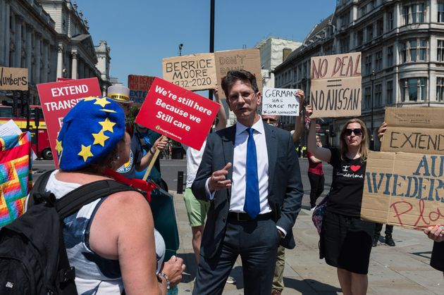 Conservative MP Steve Baker speaks with pro-EU supporters during protest outside Houses of Parliament...