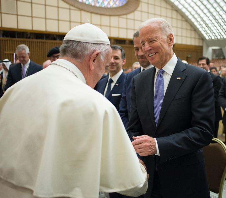 Pope Francis shakes hands with then-Vice President Joe Biden in the Pope Paul VI hall at the Vatican, April 29, 2016.