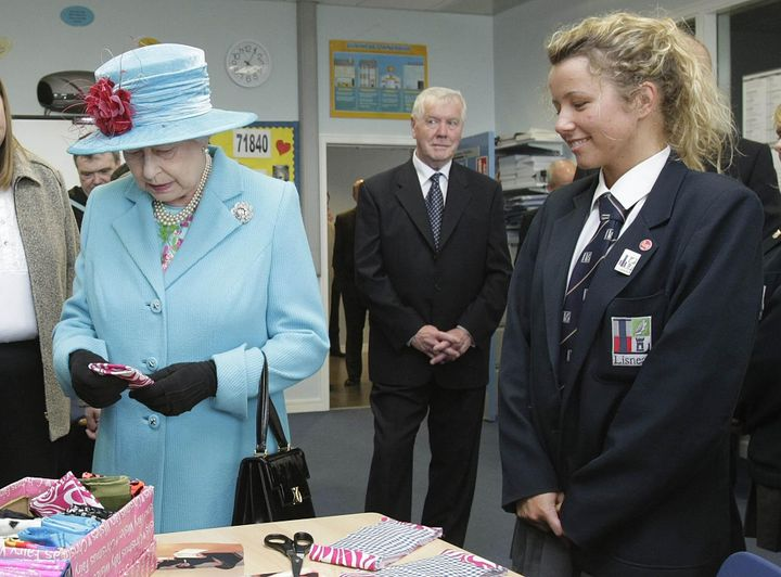 Queen Elizabeth being given a protective cover for her iPod during a visit to Northen Ireland in 2009.