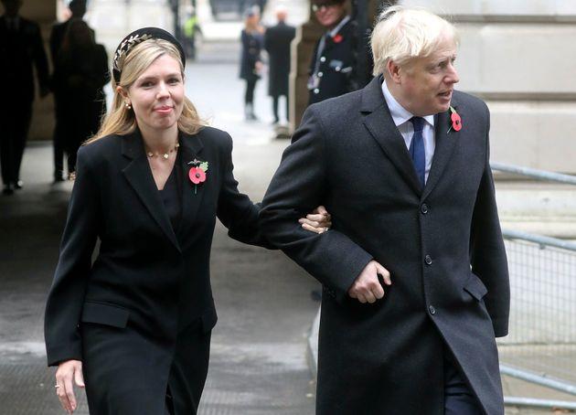 Prime Minister Boris Johnson, right, with partner Carrie
