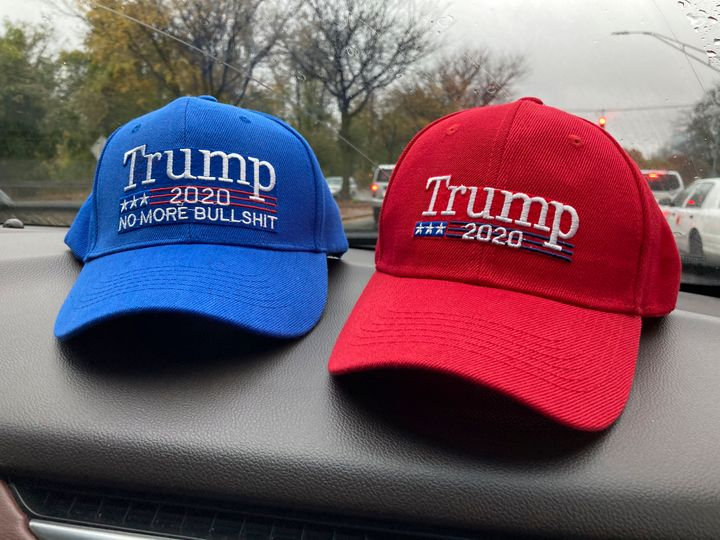 Two pro-Trump hats sit on top of a car dashboard in Nyack, New York, on Nov. 1.