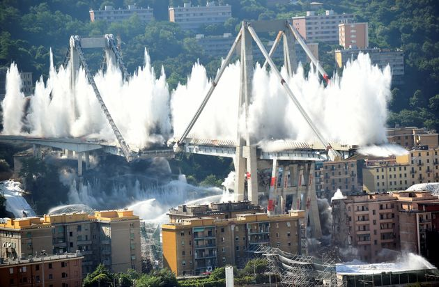 Controlled explosions demolish two of the pylons of the Morandi bridge almost one year since a section...
