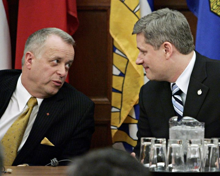 Jay Hill chats with Prime Minister Stephen Harper at a Conservative caucus meeting in Ottawa on Feb. 7, 2006.