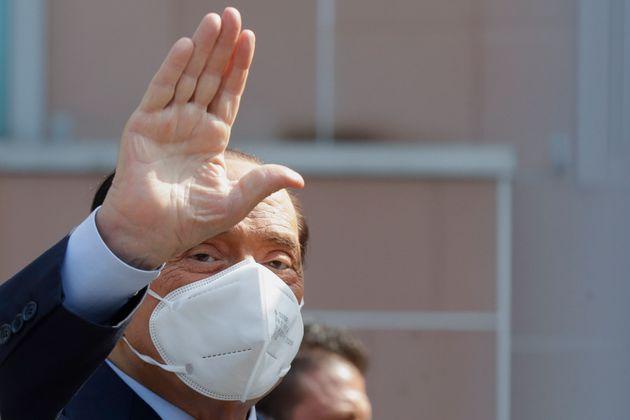 Italian former Premier Silvio Berlusconi waves as he leaves the San Raffaele hospital in Milan, Italy,...