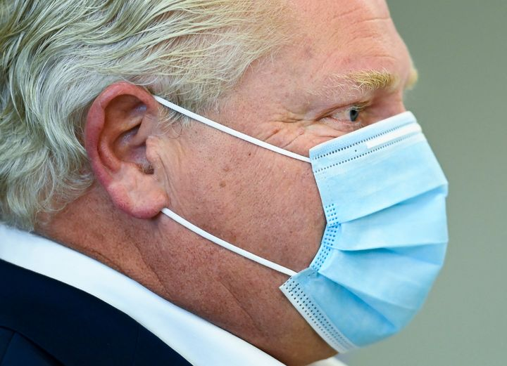 Ontario Premier Doug Ford speaks with health workers at Humber River Hospital in Toronto on Nov. 5, 2020.