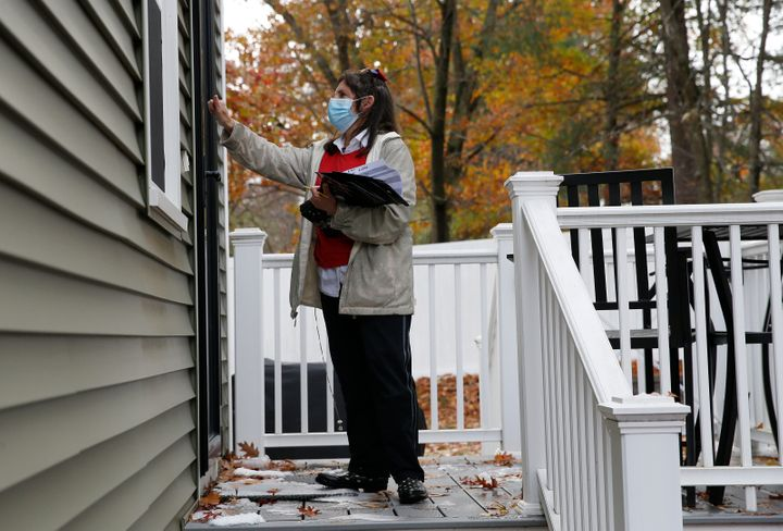 A volunteer knocks doors for President Donald Trump in Nashua, New Hampshire. The Republican National Committee modeled its f