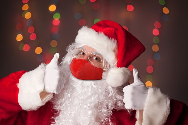 Santa Claus gives two thumbs up, assumedly to the idea of celebrating Christmas safely this