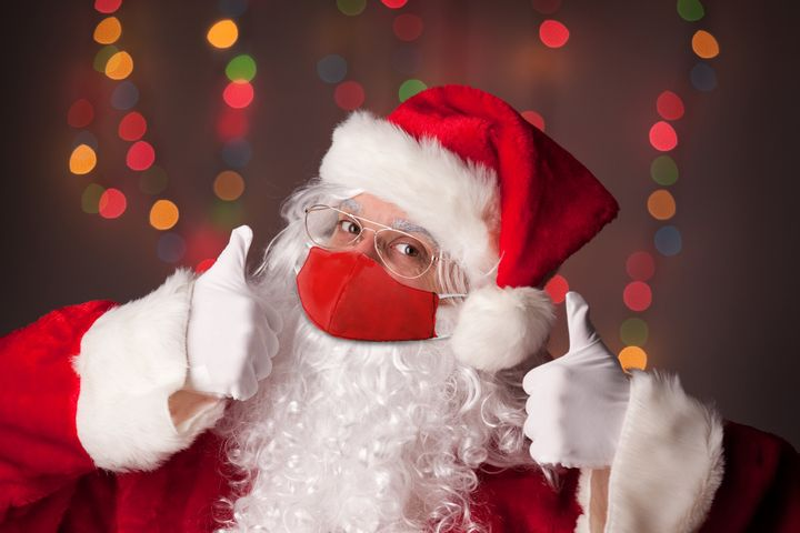 Santa Claus gives two thumbs up, assumedly to the idea of celebrating Christmas safely this year.