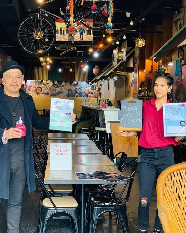 Desi Dhaba restaurant owner Amit Tuteja, pictured at left with one of his staff members, said Diwali will be different this year, with only 40 people allowed to dine at a time.