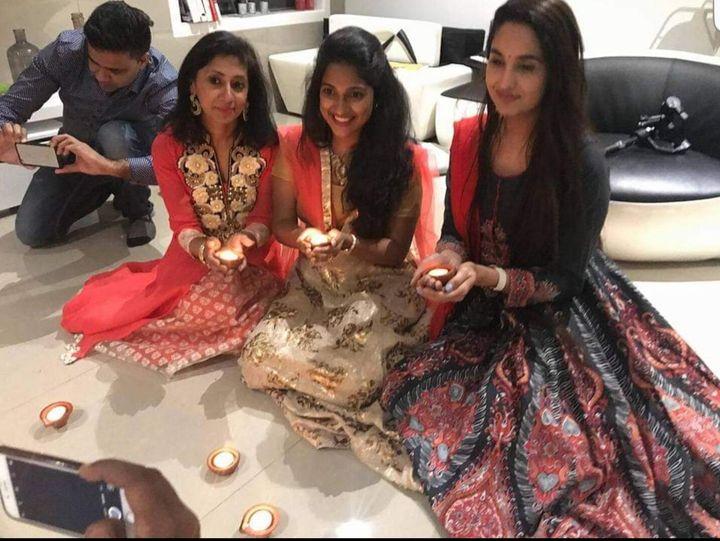 Molina Asthana andIndian playback singer Satya Yamini hold diya lamps during a previous Diwali celebration.