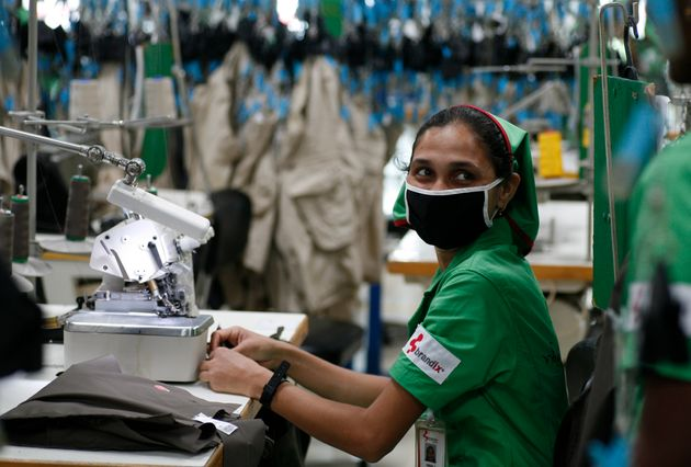 A factory worker looks on during the opening ceremony of Sri Lanka's first converted green factory by...