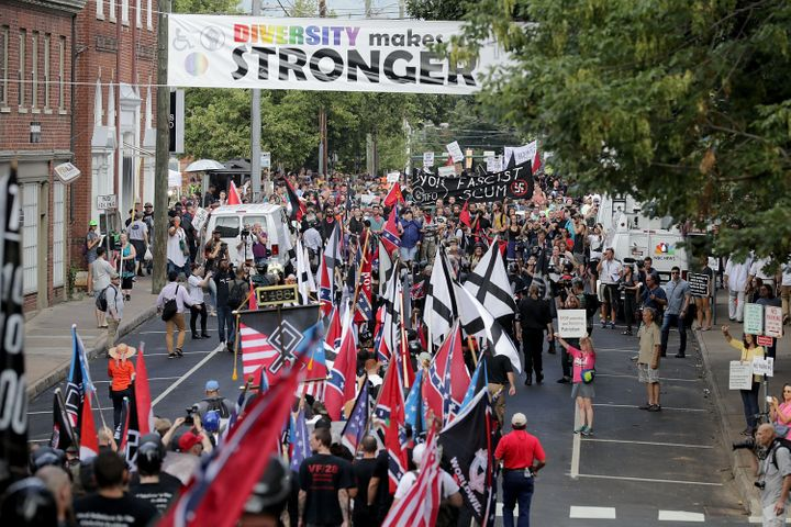 """White nationalists, neo-Nazis and members of the """"alt-right"""" march through Charlottesville, Va., during the """"Unite the Right"""" rally Aug. 12, 2017."""