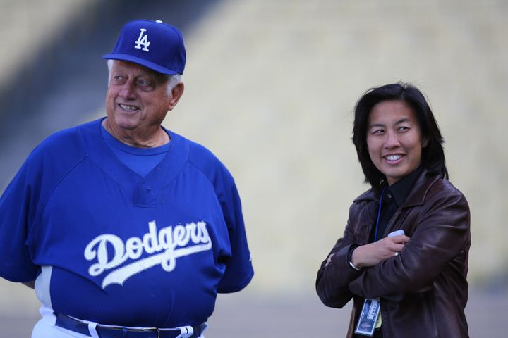Kim Ng, then the assistant general manager of the Los Angeles Dodgers, talks with former Dodgers manager Tommy Lasorda.