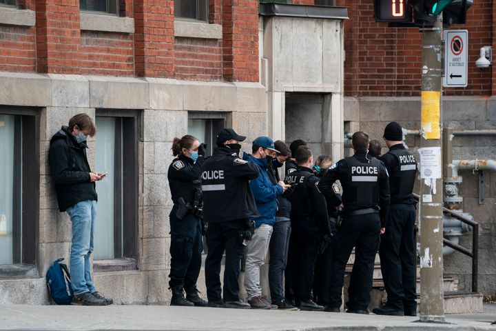 Police assemble outside the entrance to the Ubisoft building in Montreal's Mile End neighbourhood, Nov. 13, 2020.
