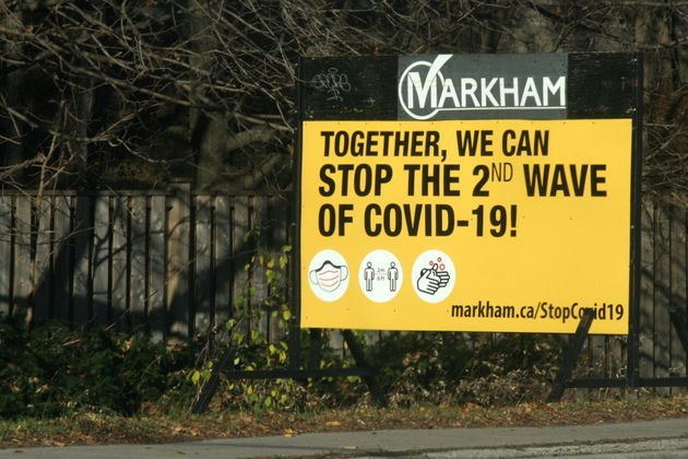 Sign urging people to do what they can to stop the second wave of the novel coronavirus (COVID-19) in...