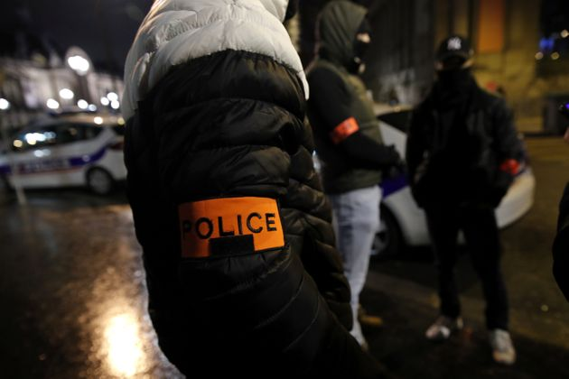 Masked police officers attend a demonstration near the Champs-Elysee in Paris, France, December 20, 2018....