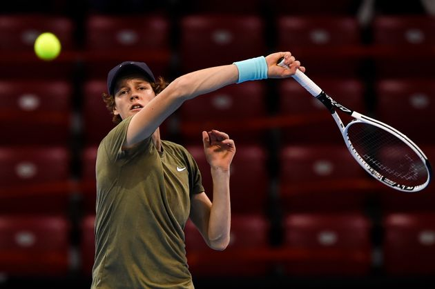 Italy's Jannik Sinner hits a return against Canada's Vasek Pospisil during the final match of the ATP...