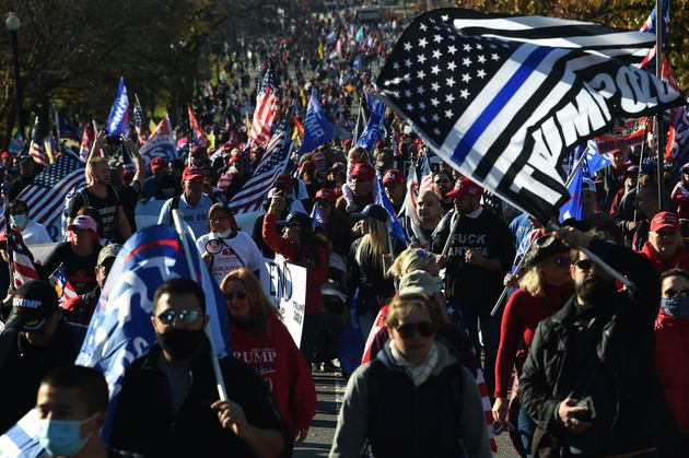 Supporters of US President Donald Trump rally in Washington, DC, on November 14, 2020. - Supporters are...