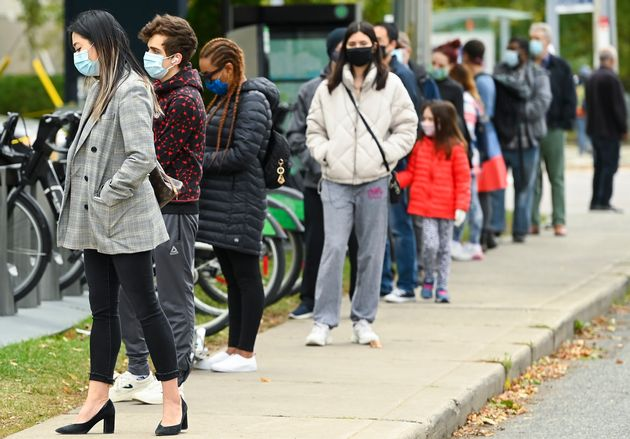 People line up at a COVID-19 assessment centre at the Michael Garron Hospital in Toronto, Thurs. Oct....