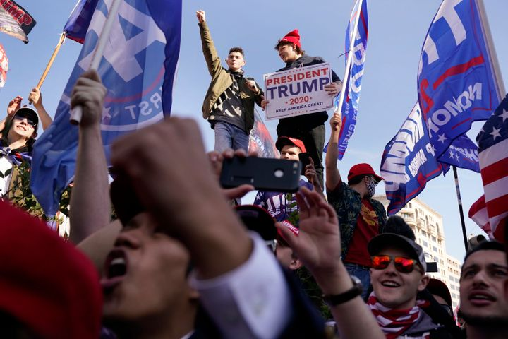 Supporters of President Donald Trump attend a pro-Trump march Saturday Nov. 14, 2020, in Washington. (AP Photo/Jacquelyn Mart