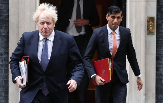 Prime Minister Boris Johnson (left) and Chancellor of the Exchequer Rishi Sunak leave 10 Downing Street
