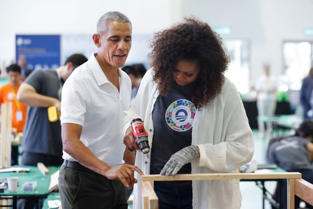 Former U.S. President Barack Obama and former first lady Michelle participate in a community services...