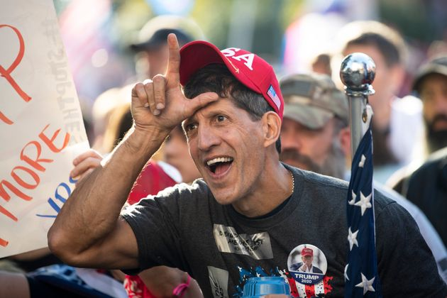 A Trump supporter yells at counterprotesters outside the U.S. Supreme Court during a protest in Washington