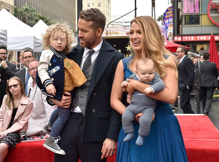 Ryan Reynolds and Blake Lively with their daughters James and Inez on the Hollywood Walk of Fame on Dec. 15, 2016.