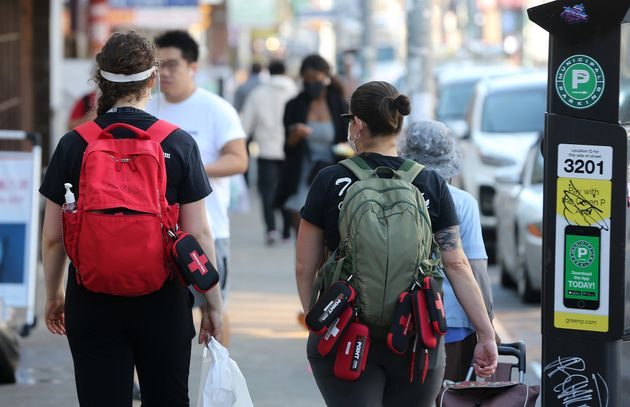 Members of POINT, Preventing Opioid Overdose in Toronto, carry naloxone kits as the COVID-19 pandemic...