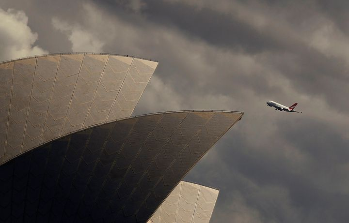 A Qantas A-380 plane flies past the Sydney Opera house in central Sydney, Australia March 11, 2013.