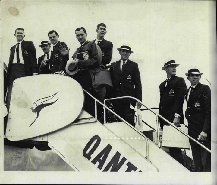 The Australian Basketball Olympic team at Mascot today board their Qantas plane for Hong Kong. September 11, 1964.