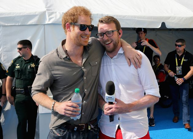 Prince Harry chats with former competitor and now commentator JJ Chalmers outside the competitor's tent during the 2016 Invictus Games in Orlando, Florida.