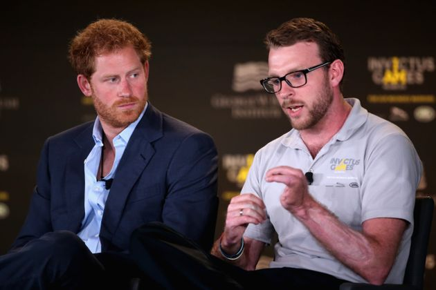 Harry and Chalmers talk at a symposium on invisible wounds on May 8, 2016, in