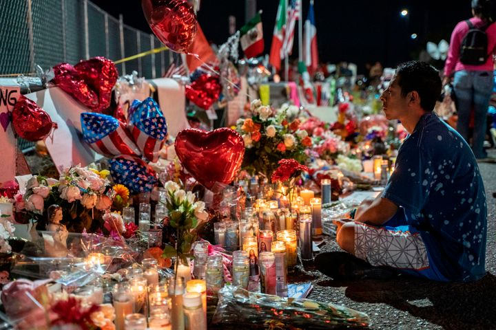 Abel Valenzuela visits the makeshift memorial for victims of the mass shooting at the Cielo Vista Mall Walmart in El Paso, Te