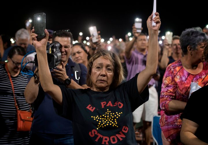 People attend a prayer vigil for the victims of the El Paso massacre. Just 13 hours after that shooting, there was another de