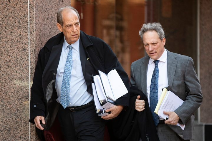 Victims attorneys Paul Mones, left, and Michael Pfau, depart during a recess in the Boy Scouts of America's bankruptcy hearin
