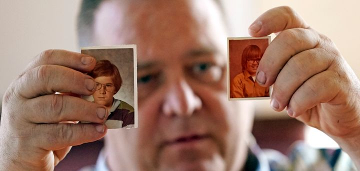 James Kretschmer holds photographs of himself at age 11 and 12 during an interview in Houston. He says he was molested by a S