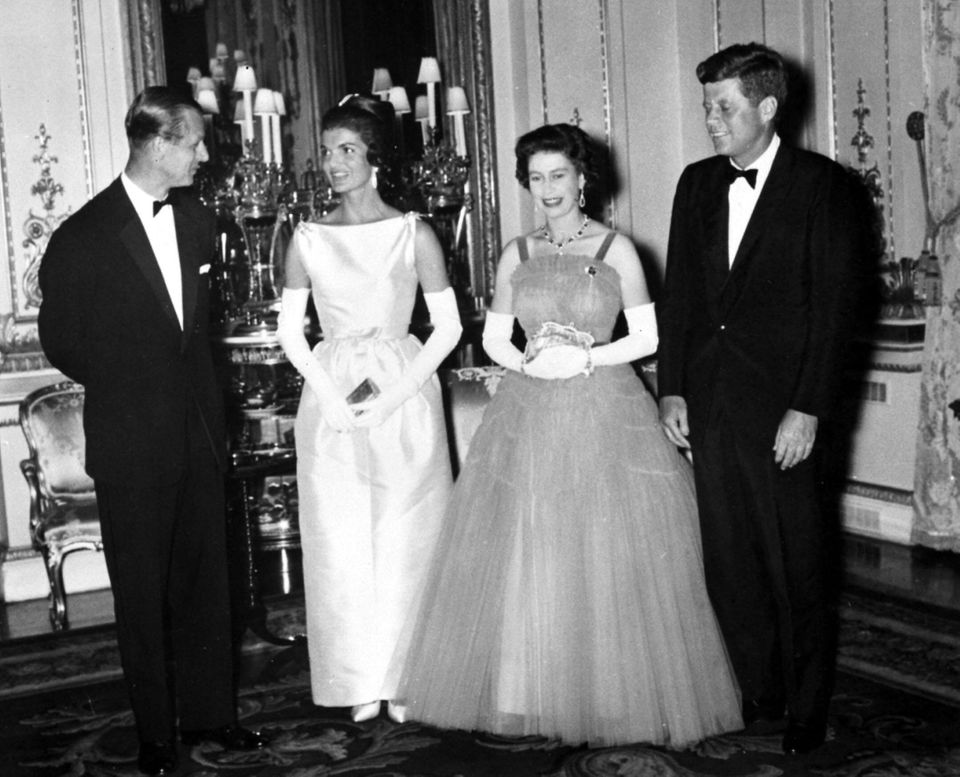 President John Kennedy (right) with his wife (second left) Jacqueline, meeting Queen Elizabeth II and...